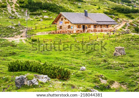 Wooden mountain hut on one of the mountain trails around the Tre Cime, Dolomitic Alps, Dolomiti di Sesto, Dolomites Mountains, South Tyrol, Italy  - stock photo