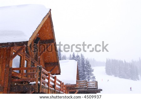 Wooden mountain lodge at downhill ski resort in Canadian Rocky mountains - stock photo