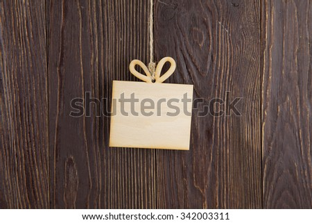 Wooden nameplate on old wood background - stock photo