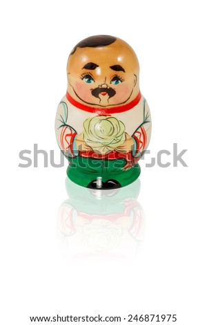 Wooden nested doll Ukrainian man with a mustache and forelock holding cabbage isolated on white background - stock photo