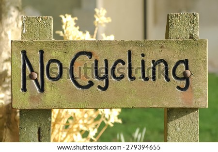 wooden no cycling information sign - stock photo