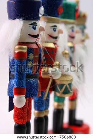 Wooden Nutcracker Soldiers in a row - stock photo