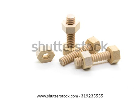 Wooden nuts and bolts isolated on white background