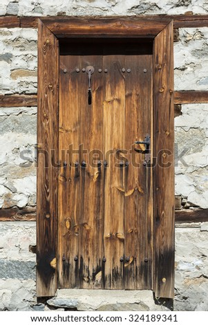 wooden oak door with metal hinges and nails - stock photo