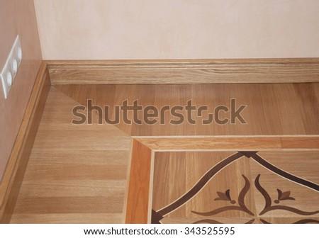 Wooden Oak Parquet Floor Texture Background. Closeup on  Baseboard Oak Wood Parquet Flooring - stock photo