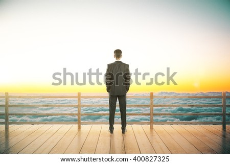 Wooden observation platform with sea view and businessman