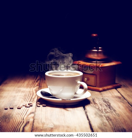 wooden old desk and coffee with smoke  - stock photo