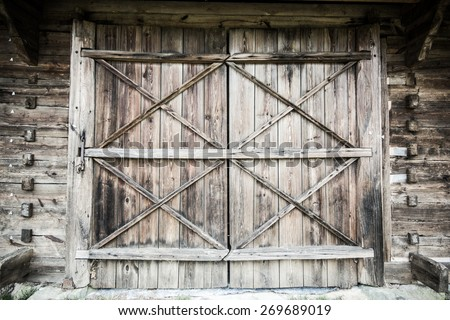 Wooden old door with lock texture.
