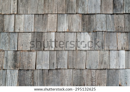 Wooden old retro style roof texture on old house - stock photo