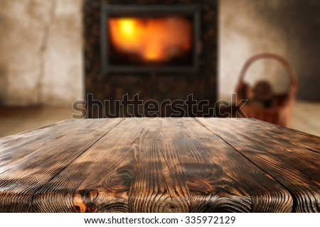wooden old table place and fireplace  - stock photo