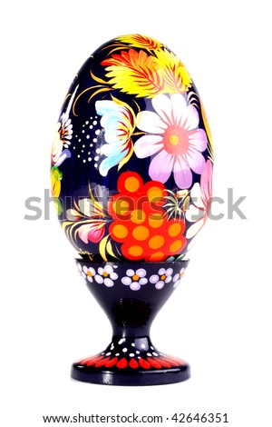 Wooden painted egg in style of Russian varnish list on a support. On egg flowers a symbol of the Russian village are drawn.