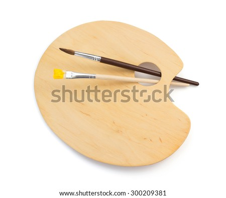 wooden palette and paintbrush isolated on white background - stock photo