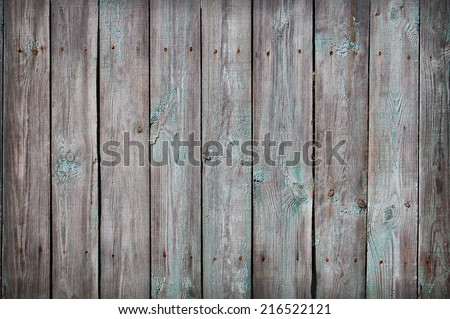 Wooden Palisade background. Close up of grey and green wooden fence panels. Old wooden fence. wood texture background. wood fence background - stock photo