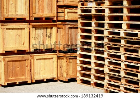 Wooden pallet bunch in warehouse - stock photo