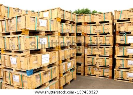 Wooden pallets arrangement on the rack in warehouse - stock photo