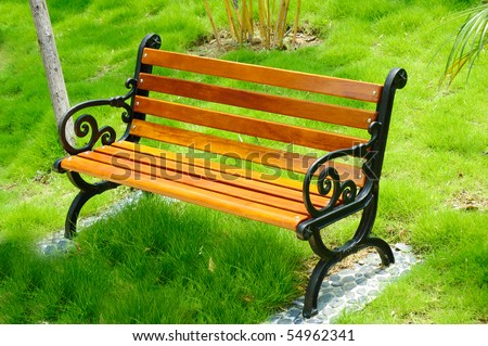 Wooden park bench at a park in China - stock photo