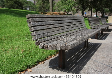 wooden park benches in urban downtown