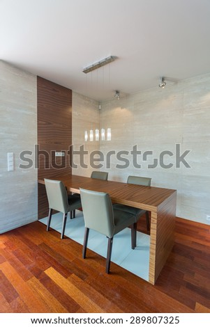 Wooden parquet and table in dining room