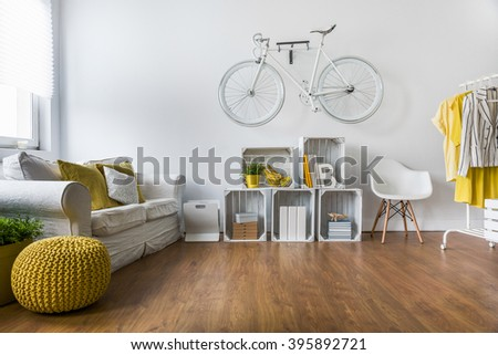 Wooden parquet in big living room with comfortable white sofa and vintage decorations - stock photo