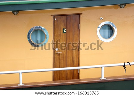 Wooden passenger cabin with round portholes on a Historic Steam River Boat on Fraser River New Westminster BC - stock photo