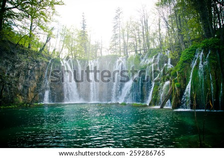 Wooden path and waterfall in Plitvice National Park, Croatia  - stock photo