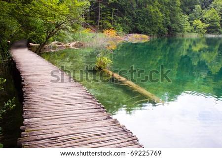 wooden path over Plitvice lake, Croatia - stock photo