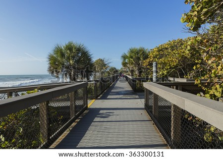 Wooden path to the beach. Florida - stock photo