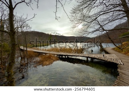 Wooden path trough the lakes angle shot - stock photo