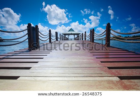 Wooden pathway leading to beautiful hut