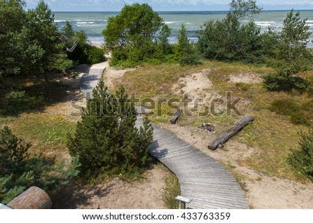 Wooden pathway to sea