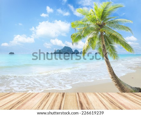 Wooden paving and beautiful beach with coconut palm tree. Ao Nang Krabi, Thailand. World Water Day, Environment, Ecology concept. - stock photo