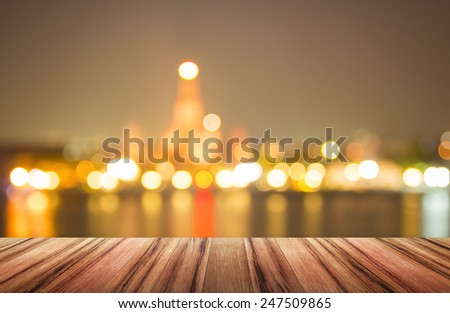Wooden paving and blurred Wat Arun on sunset. - stock photo