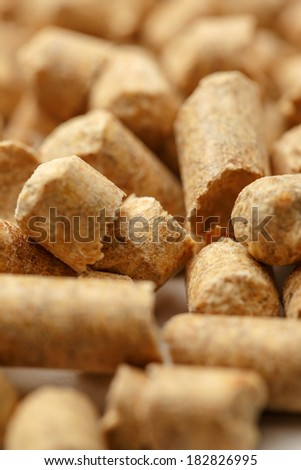 Wooden pellets closeup as background - stock photo