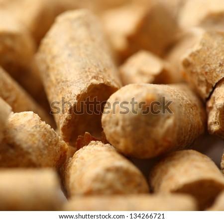 Wooden pellets closeup background - stock photo