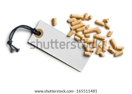 wooden pellets with price tag on white backround - stock photo