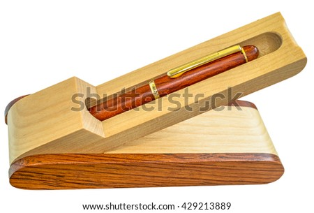 Wooden pen stand with ballpoint wooden pen isolated on white background. - stock photo