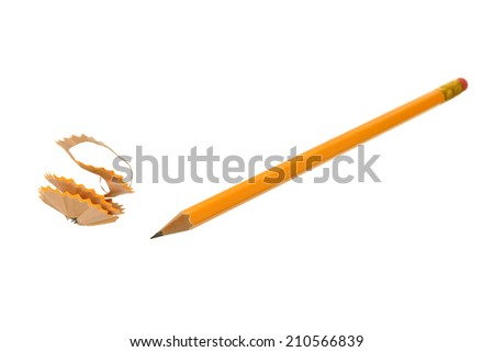 Wooden pencil shavings with pencil on white paper background - stock photo