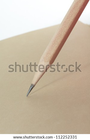 wooden pencil writing on brown paper book