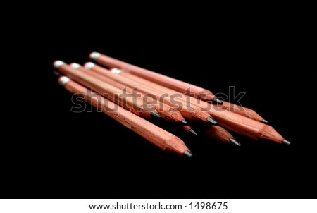 wooden pencils on a black background
