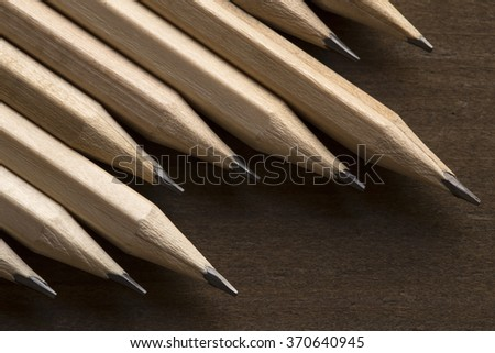 Wooden pencils on brown background - stock photo