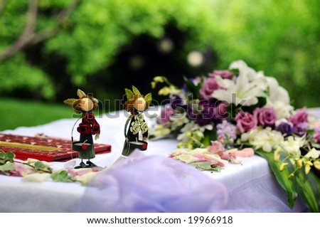 Wooden People Wedding on the Table - stock photo