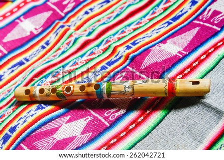 wooden peruvian flute with traditional cloth