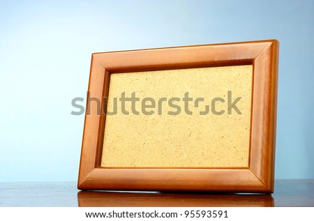 wooden photo frame on a blue background - stock photo