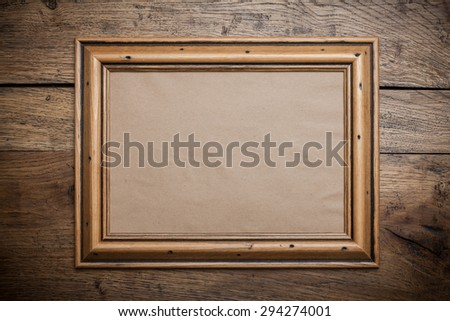 Wooden photo frame with kraft paper with free space on the wall