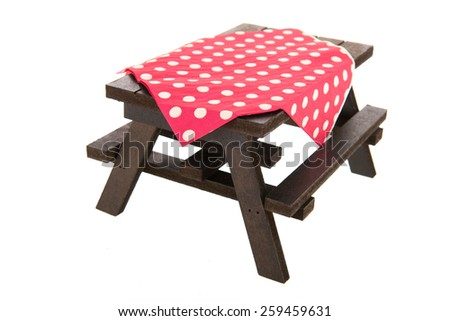 wooden picnic table and seats isolated over white background - stock photo