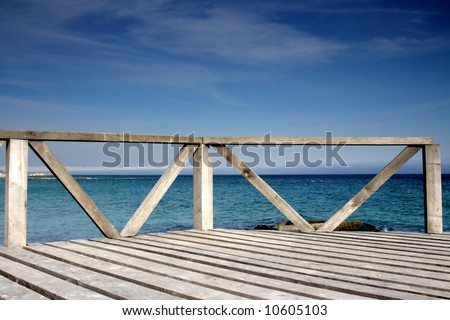Wooden pier against the blue sky