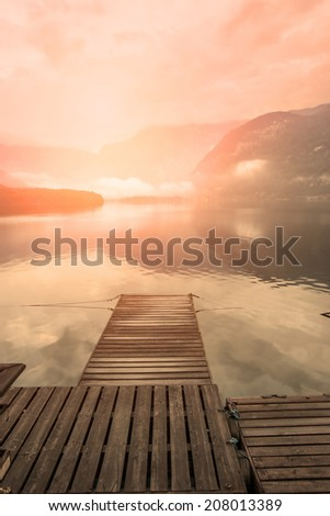 Wooden pier and alpine landscape - stock photo