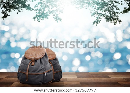 wooden pier and backpack at travel summer time - stock photo