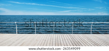 wooden pier and sea view in sunny day - stock photo