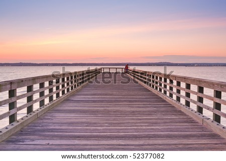 Wooden Pier at sunset - stock photo